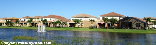 Many of the elegant homes in Boynton Beach's gated Canyon Trails community overlook a scenic lake view. Picture yourself relaxing on your patio while looking out to the lake with its fountain, and the well-kept grounds beyond.