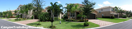 Well-kept lawns and pleasant landscaping are found throughout Boynton Beach's Canyon Trails community.